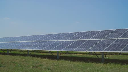 enviroment : Solar power station on meadow.