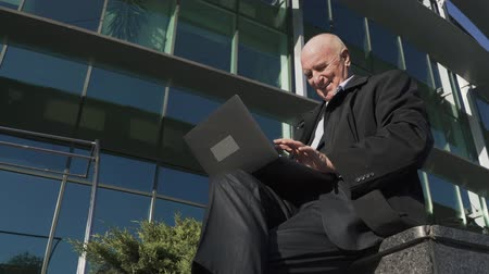 netbook : Adult man is working with laptop in the city