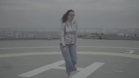 maiden : A young girl walks in windy weather. Slow motion, s-log, ungraded