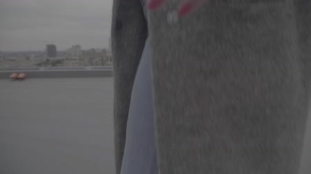 maiden : Stylish lady in high heels and gray coat outdoors. Slow motion, s-log, ungraded Stock Footage