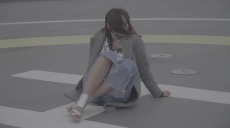 maiden : Lovely girl with dark hair in a gray coat outdoors. Slow motion, s-log