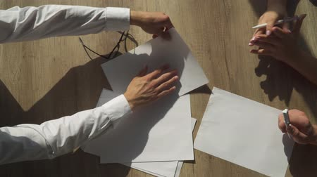 segregatory : Hands of office workers work with paper