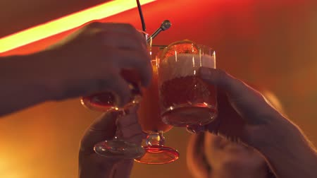 karczma : Young people clink glasses with a cocktail Wideo
