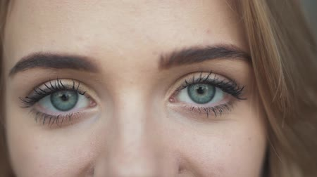 brow : Beautiful girl is looking on camera closeup Stock Footage
