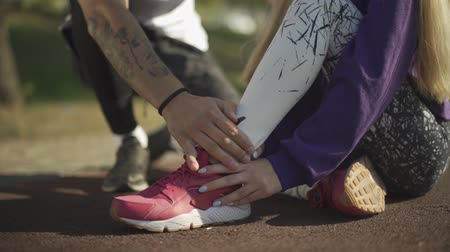 athletes foot : Handsome oung man cares for the girl who sprained his leg