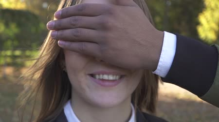 gözlem : African American hand closes the eyes of a girl Stok Video