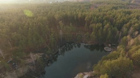 yüksek ova : A top view of a lake in the middle of the forest. Shooting from the drone.
