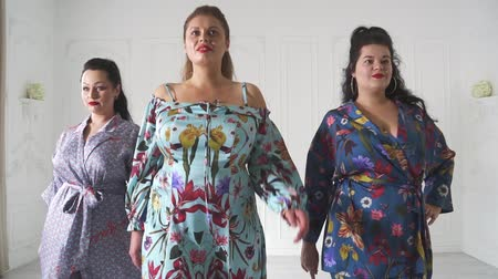 xxl : Plus size models in a beautiful dresses in the studio. Smiling plump women posing in beautiful outfits.