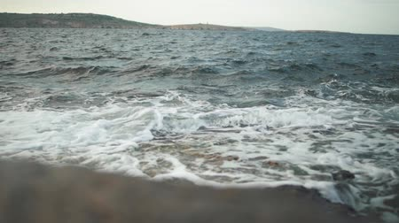 sputter : View of the sea waves breaking on the stones. Stock Footage