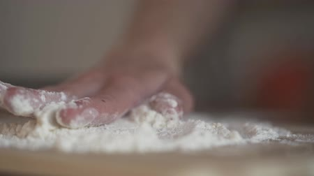 poured out : Female chef prepares dough for making pasta, slow motion, dolly shot.