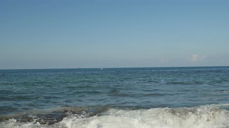 kenu : Morning view of nice summer day in Cyprus. Foam smooth waves beat on the rocks, clean water, clear horizon line.