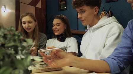 beatiful : Students share their impressions and discuss sitting at a table with books in a cafe. Teens lead a healthy lifestyle and prepare for tests.