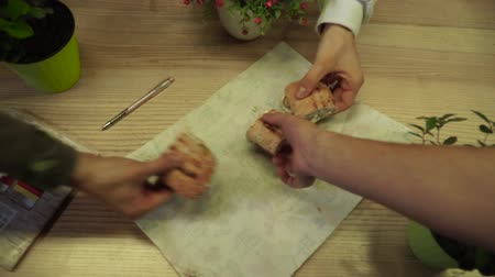 ayrılmış : Students hands taking a sandwich cut into three pieces lying on the table
