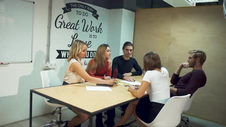 çözmek : Young entrepreneurs discuss new strategies in start-up using laptops in office meeting room Stok Video