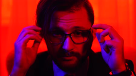 beardie : Portrait of bearded man with glasses looking in camera. Shooting in red light