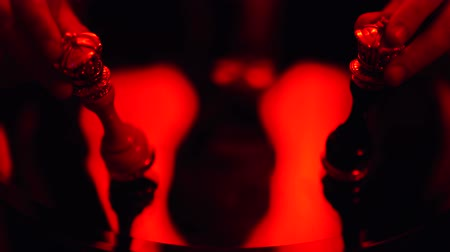 porażka : Male hand dropping a chess figure standing on the table in bright red light. Wideo