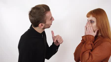 sem problemas : Angry agressive man yelling at his beautiful girlfriend with long red hair. Woman close her face and ears, she can not listen this bad words. Stock Footage
