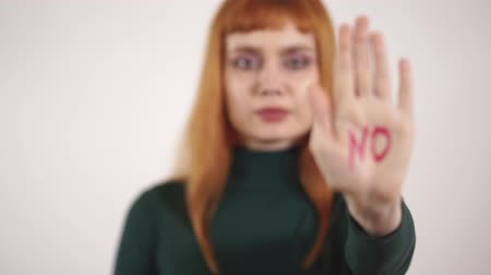 no hands : Portrait of strict young woman with written sign at her hand no Stock Footage