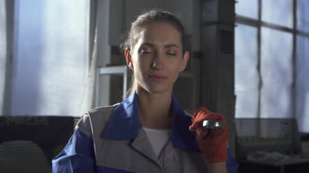wrench : Portrait of a beautiful cute girl in a uniform standing with a spanner in the service station