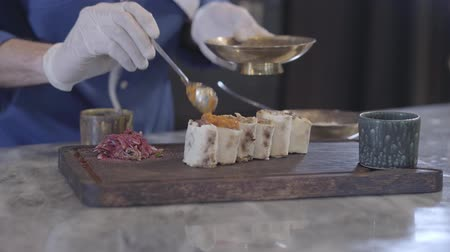 lavash : Chef cooking tasty dish in modern restaurant close up. Hands of man in cook uniform and rubber gloves putting topping on cutted lula kebab in lavash pita rolls. Turkish cuisine Stock Footage