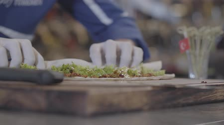 lavash : An experienced chef in white chef gloves wraps mouth-watering stuffing into the dough. The chef prepares a delicious dish in the kitchen of an expensive restaurant. Stock Footage