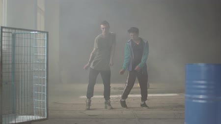 hiphop : Two successful hip-hop dancers dancing street dances in an abandoned building. Friends practicing in break-dance. Hip hop culture. Rehearsal. Contemporary.