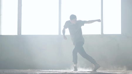 biodro : Young hip-hop dancer performing in the fog. Hip hop culture. Rehearsal. Contemporary.
