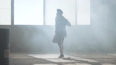 simultaneously : Young man dancing in an abandoned building. Hip hop culture. Rehearsal. Contemporary. Stock Footage