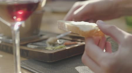 pasztet : Female hand smearing on bread delicious cheeses and sauces from beautifully served plate in restaurant. Close up Wideo