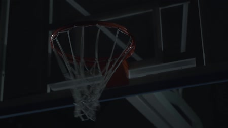 altura : Basketball net close up. A man, player put a ball inside basketball hoop. Stock Footage