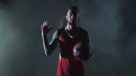 életerő : Handsome young unshaved brutal basketball player spin a ball on finger