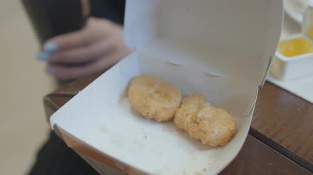 安い : Female hand taking chicken nuggets from box close up. 動画素材