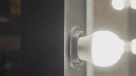 adaptador : Mirror with the included light bulbs on small production close up.