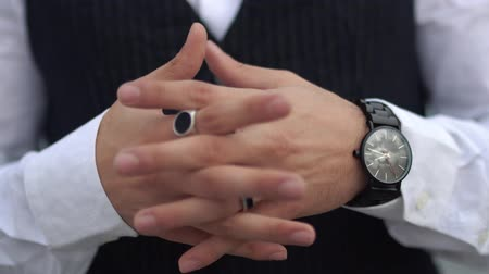 classical suit : Crossed fingers close up of stylish man in a white shirt. Stylish watch on the hand of the big boss.