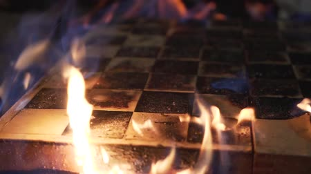 mysticism : Burning chessboard close-up. Shooting a clip. Slow motion Stock Footage