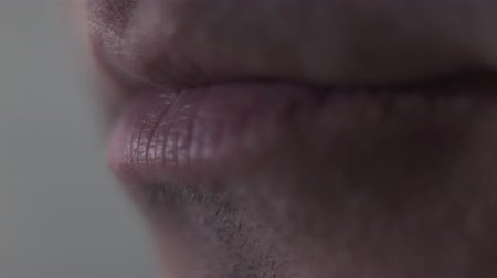 part of clip : Male chewing lips close-up. Part of face. Stock Footage