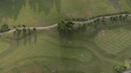 çimenli yol : Aerial view of large luxury golf course. View of the green lawns and trees. Shooting from above, top view, drone shooting.