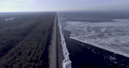 pole street : Aerial dron view of the ice glaciers near coastline of winter frozen sea, forest with winter tree and road.