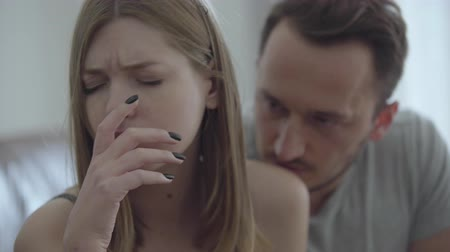 divorcement : Close-up portrait of sad broken woman and her husband asking for forgiveness. Problems in the relationship between man and woman. Betrayal, mistrust, breakup concept. Misunderstanding in family. Stock Footage
