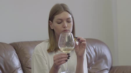 zdrada : Sad woman holding wedding ring under the wine glass. Family problems. Betrayal, divorce, breakup concept. Restless girl having problems in personal life suffers break up, misunderstanding in family. Wideo