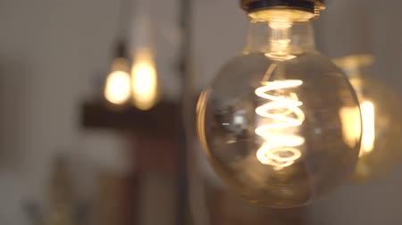 filamento : Tungsten light bulb lamp close-up. Concept of light, idea, electricity at modern home. Stock Footage