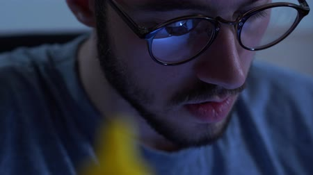componente : Portrait of successful young bearded man in glasses working with a soldering iron at his working place. Concept of the profession, accurate work, engineer position Stock Footage