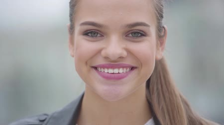 fashion outlet : Close-up portrait of adorable confidence happy girl looking at camera outdoors. Real people series. Slow motion. Stock Footage