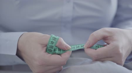 female measurements : Close-up of unrecognizable woman working with the meter, measuring the distance before sewing clothes. Concept of job, profession, hobby Stock Footage