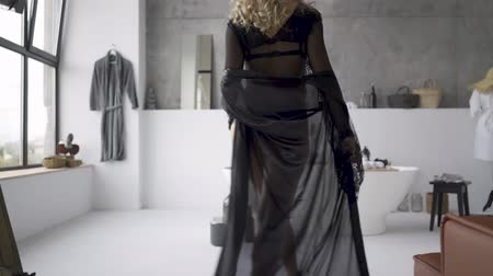 eşek : Unrecognizable young blond woman in beautiful clothes with slim body walking toward the bath in the bathroom. The girl preparing for the date. Happy mood Stok Video