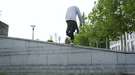 능력 : Skill man with one leg on crutches doing flip in the street. Disabled person training and doing tricks. Motivation, active lifestyle, never give up 무비클립