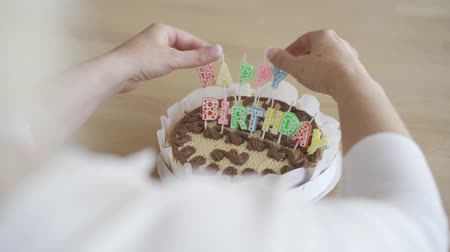 diner : Close-up hands of senior woman preparing cake for her child or grandchild. Birthday celebration concept. Caring granny preparing present