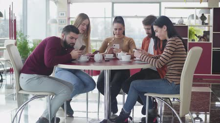 obsession : Group of Caucasian friends using smartphones as sitting together in cafe. Digital addicted man showing something in the phone to fellows. Modern communication, lifestyle, Internet addiction.