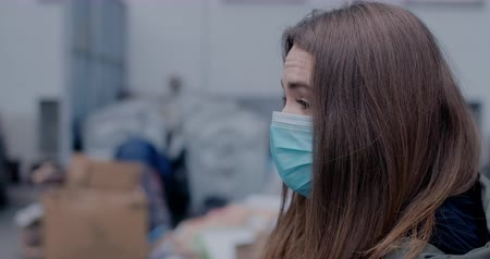 antibody : Side view close-up of brunette woman adjusting protective mask. Young lady outdoors on city street. Coronavirus, Covid-19, pandemic, risk. Cinema 4k ProRes HQ. Stock Footage