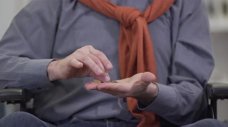 social inequality : Close-up of mature male hands counting coins. Elderly Caucasian man holding little money in palms. Poverty, retirement, pension. Stock Footage
